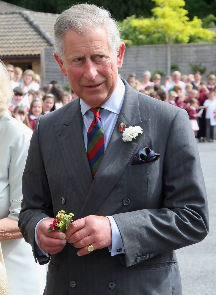 The Prince of Wales using his pocket square to pick up multiple colours in his tie, as well as the red in his lapel pin