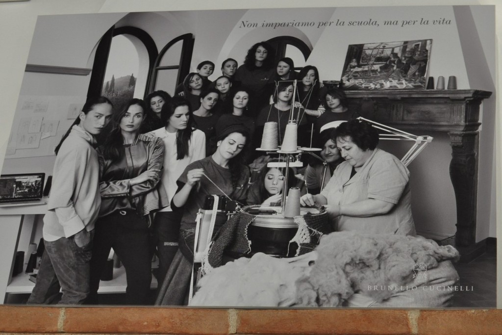 "A picture on the wall above the fireplace, comprised of teachers and students of the school, reads (translation) ""We learn not for school, but for life"""