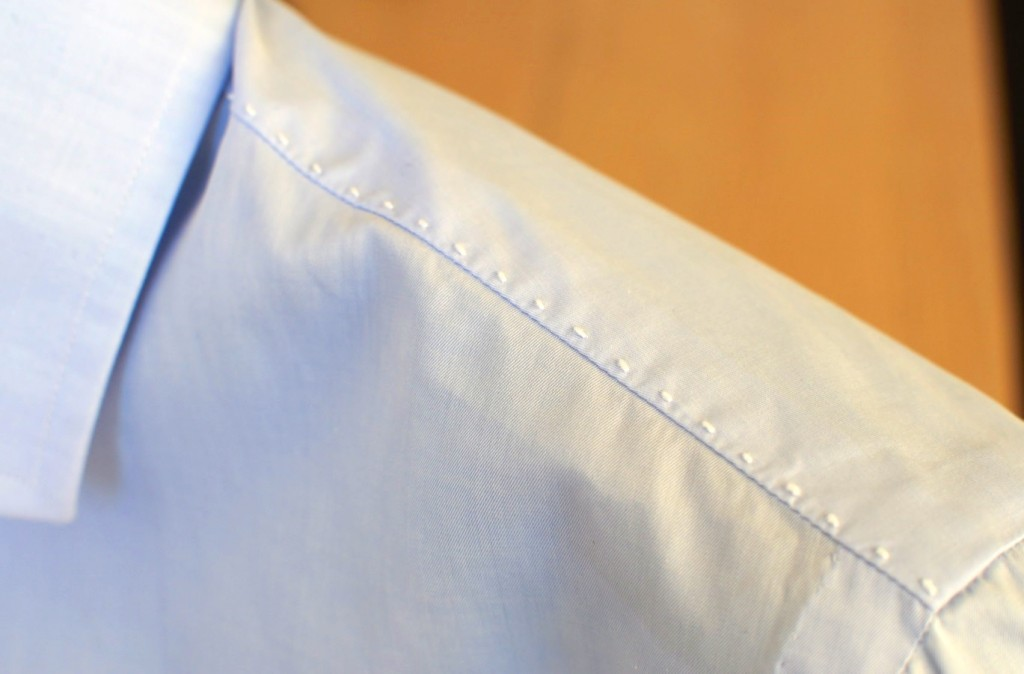 Raised hand stitching along the shoulder seam