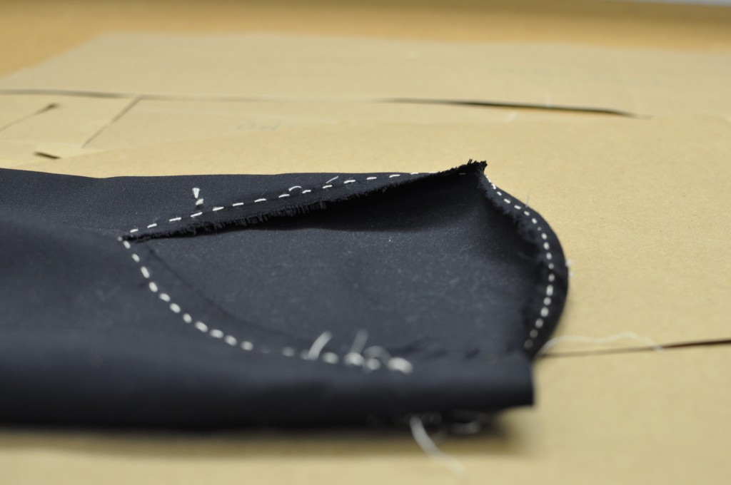 The top of the sleeve, where it will attach to the body (right side of image), with shape sewn in, creating the roped effect.