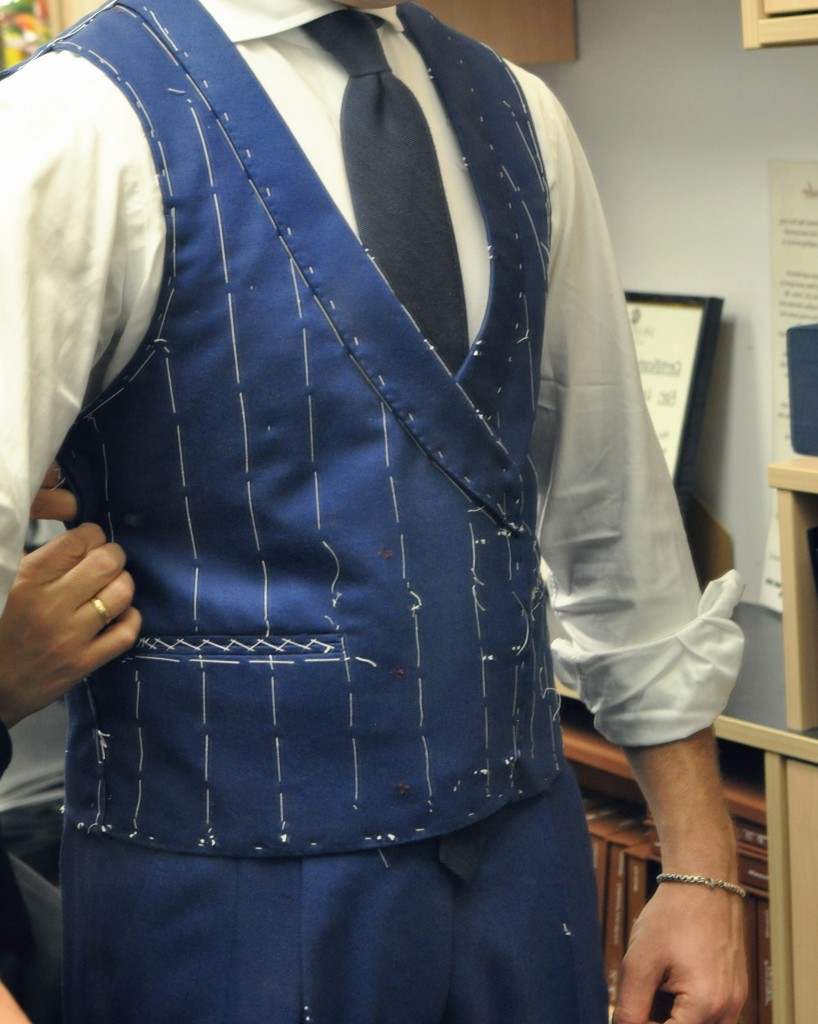 The waistcoat being taken in. As a waistcoat sits directly against the body, it needs to be well fitted or risks looking like a sack.