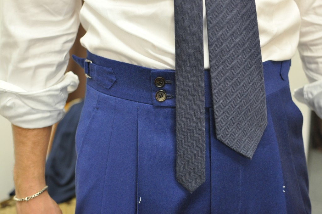 The trousers have come together very well. The 2 inch waist band is comfortable, secured by a dual button closure. Double reverse pleats add room in the thighs and the side adjuster tabs keep the look clean and means the waistcoat doesn't have to get over the bulk of a belt and belt loops.