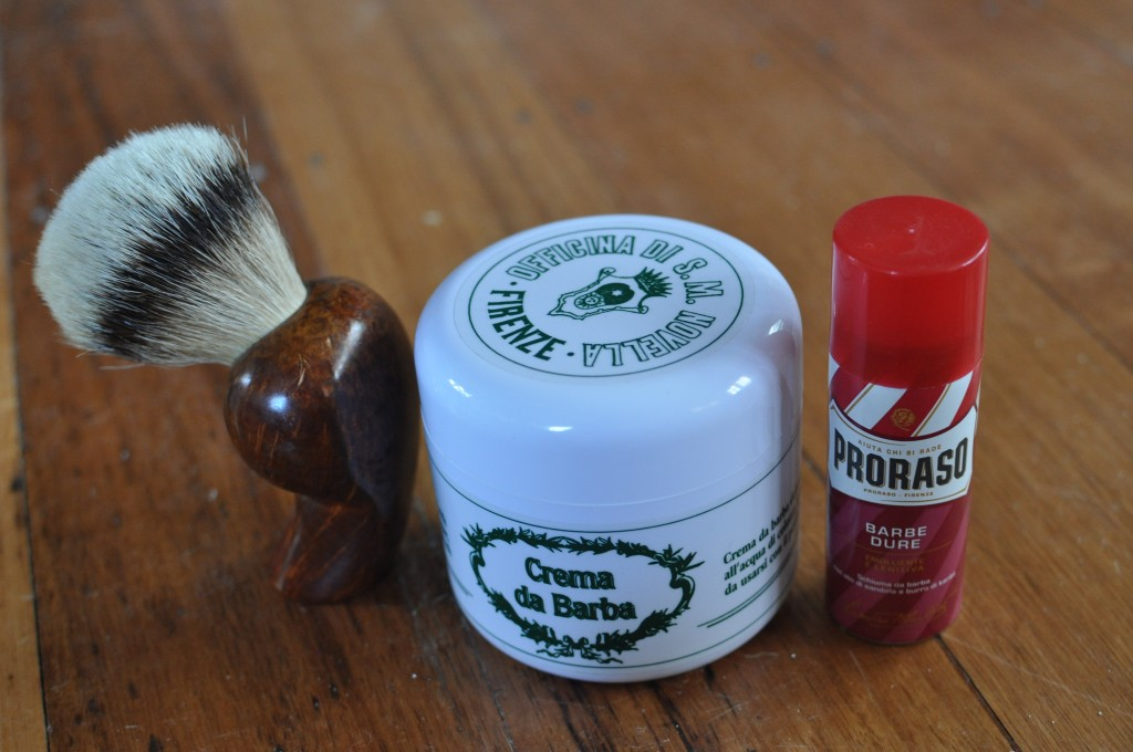 Travel Light: The difference in size between my daily shaving accessories of Marfin badger brush and Santa Maria Novella Crema di Barba and my travel option of Prorasso shave creme