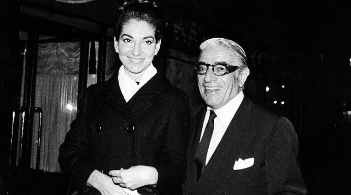 Onassis' famous wide-armed frames.